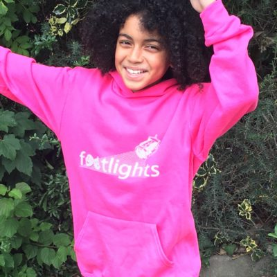 A young person in a pink hoody